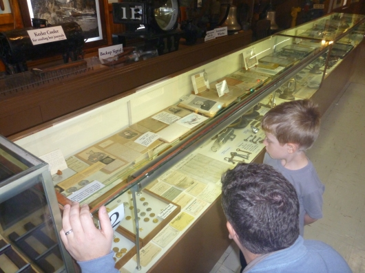 C shows T some old railroad buttons and other hardware at the Lomita Railroad Museum.