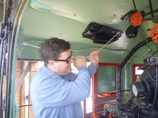 "C rings the bell on the ""Mogul"" engine at the Lomita Railroad Museum."