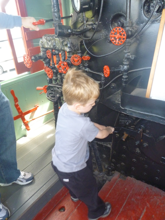 "T messing with the old panel of switches and valves inside the ""Mogul"" at Lomita Railroad Museum."
