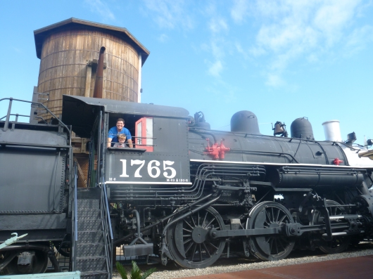 Two very happy boys chugging along at the Lomita Railroad Museum.