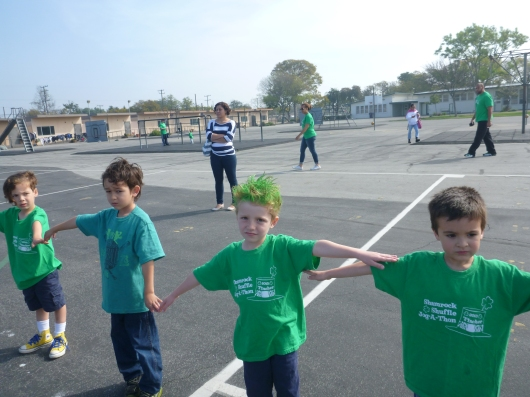 T and classmates warm up for their Shamrock Shuffle!