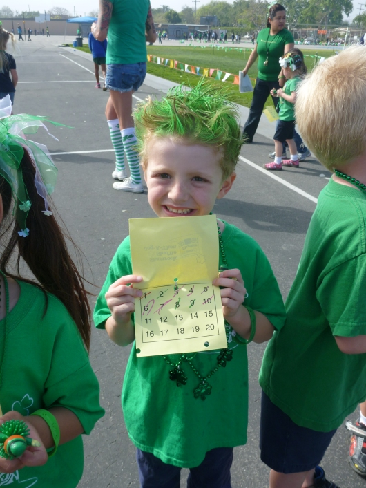 T with his jog-a-thon lap card. He ran 10 laps! Way to go, T!