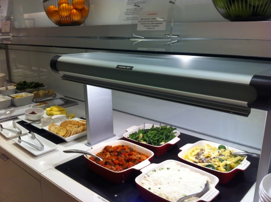 Hot appetizers and entrees in the oneworld First Lounge at LAX.
