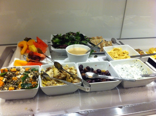 Cold appetizers like hummus and other salads and dips in the oneworld First Lounge at LAX.