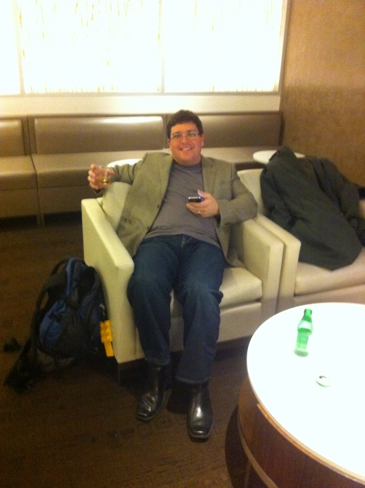 C relaxing into vacation mode in the oneworld first-class lounge at LAX.
