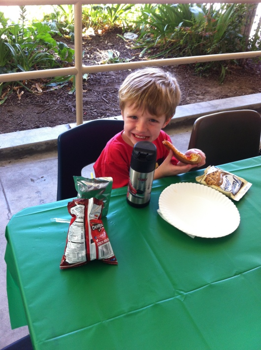T enjoys his jog-a-thon reward of free dress and a PTA-sponsored pizza lunch! Great work, T!