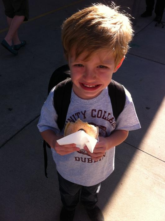 T enjoys his raised sugar donut!