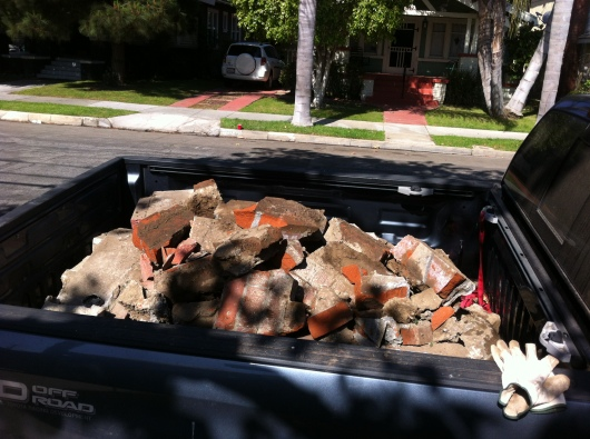 C said the wreckage weighed in at over a ton when he and T took it down to the dump last Saturday. Who knew a little brick wall weighed so much?!