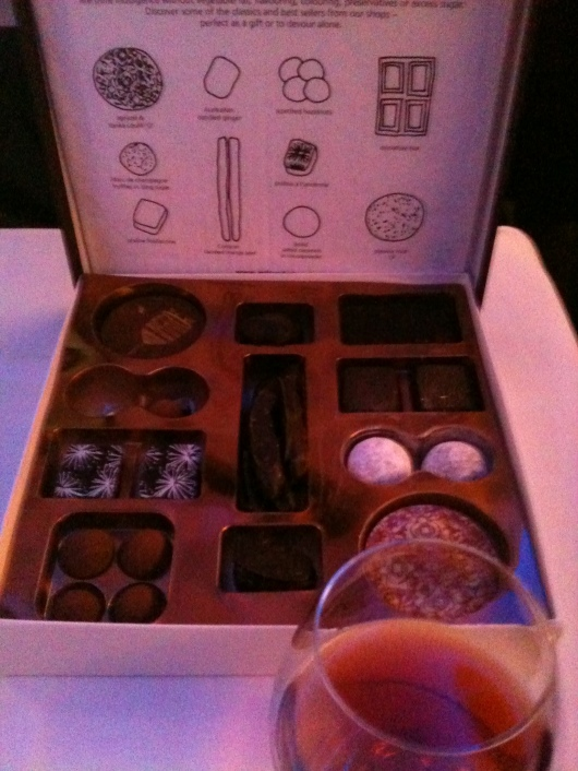 I was awestruck that the flight attendant simply left me this entire box of Artisan Indulgence chocolates at my table setting. Did she have any idea what she was doing?!