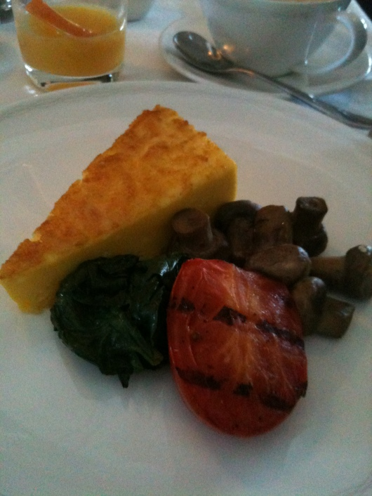 My breakfast in BA's First cabin: Cheese fritata with grilled tomato and mushrooms.