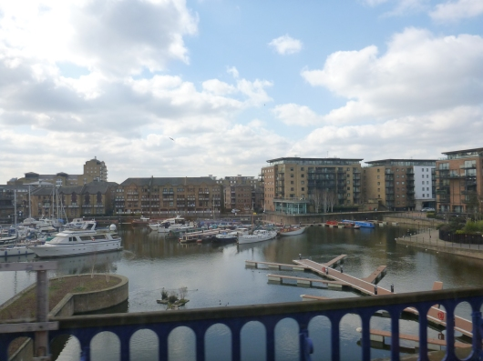 "A view from our DLR train ride from London to Greenwich. There are many Quays (""keys"") like this during the train ride, making for a very scenic start to our day out in Greenwich."