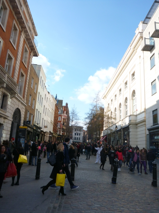 Note the number of shopping bags along Covent Garden's main thoroughfare.