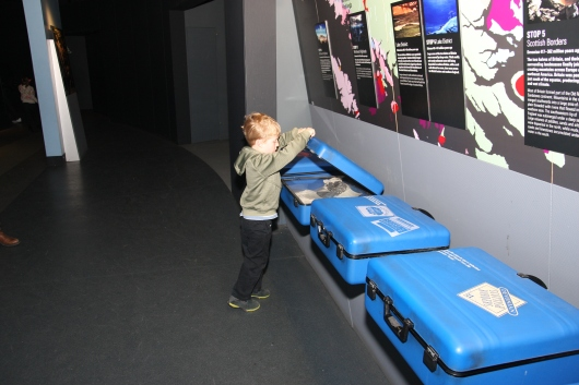 T checking out the suitcases in a geology gallery at NHM, London.