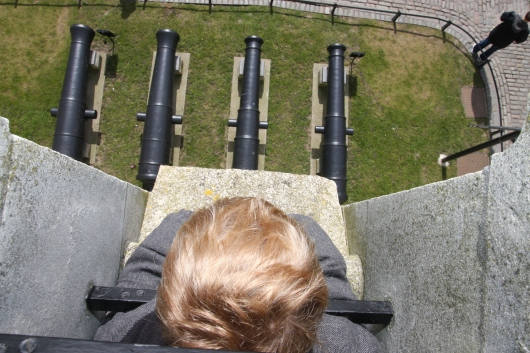 T looking down at more canons at the Tower of London.