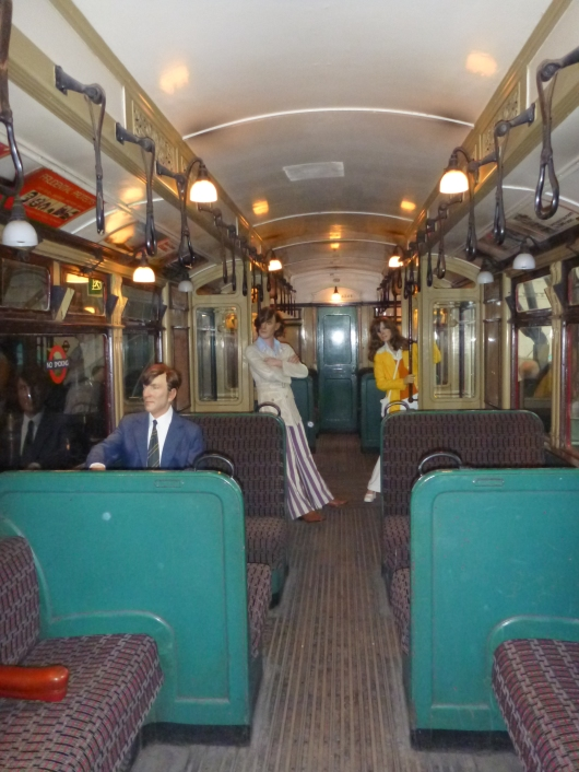 A real-scale diorama of how passengers might have looked on an old Tube car at the London Transport Museum.