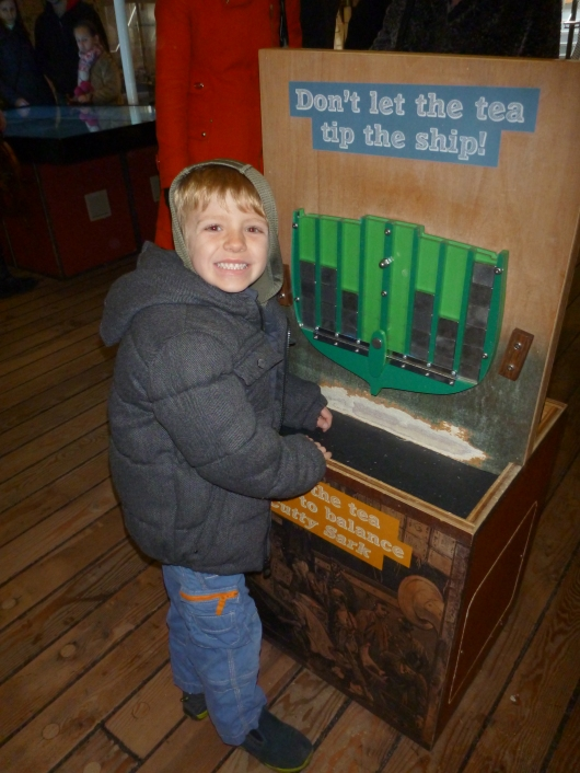 "T balancing ""tea crate tokens"" aboard a Cutty Sark puzzle on its tween deck. What great educational and FUN activities they have here!"