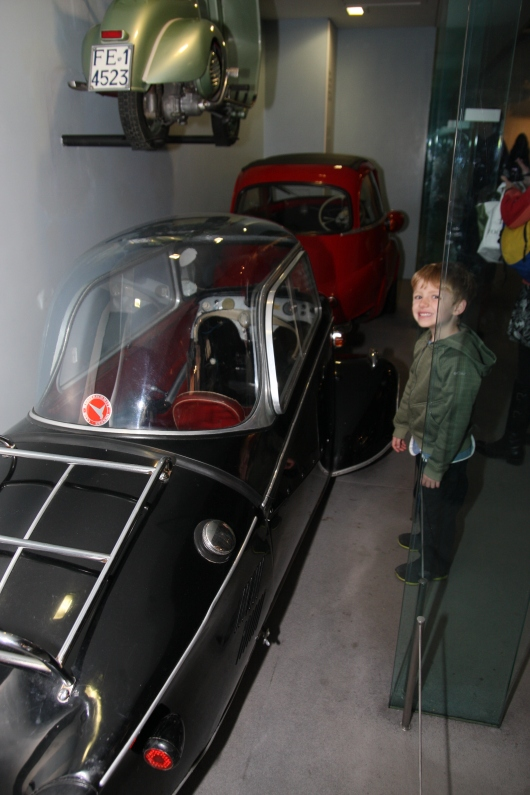 T with one of the model cars inside of Science Museum, London.