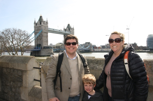 Us at the Tower of London with a view of the Tower Bridge in the background.