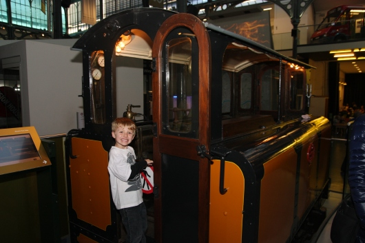 T barely boards this street car at the London Transport Museum. I think this is one of the cars that was formerly pulled by horses before buses came along.