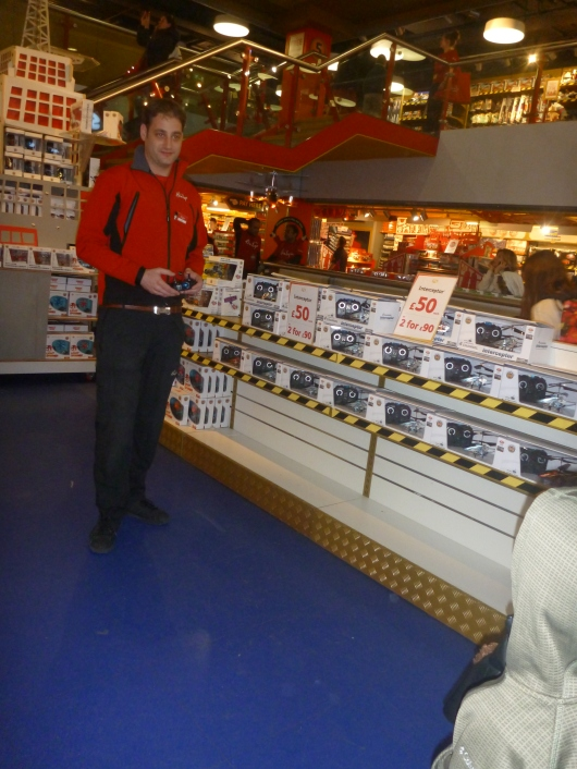 A worker demo's a RC helicopter inside of Hamleys toy store on London's Regent Street.