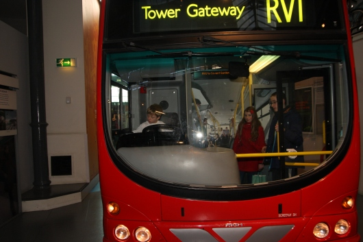 T drives a more modern double-decker bus at the London Transport Museum.