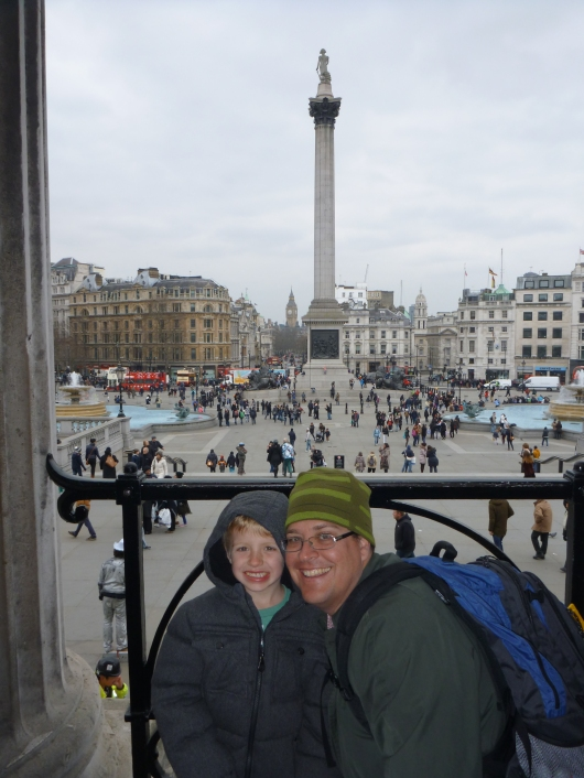 T and C on the balcony in front of the National Gallery looking out over Trafalgar Square.