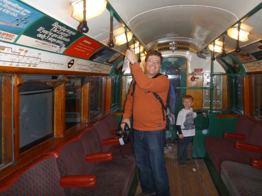 C and T inside an old Tube car at the London Transport Museum.