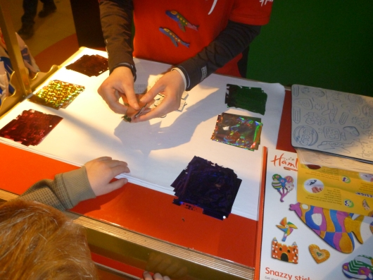 At this station, a Hamleys worker showed us how this DIY sticker kit worked. T got to keep the sticker they made together.