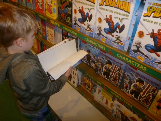 Speaking of stickers, T loved the sticker books for sale at Hamleys in London.