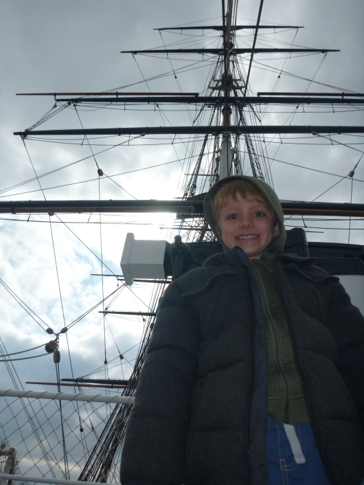 T standing at attention under the masts of Cutty Sark. Just look at that sky!