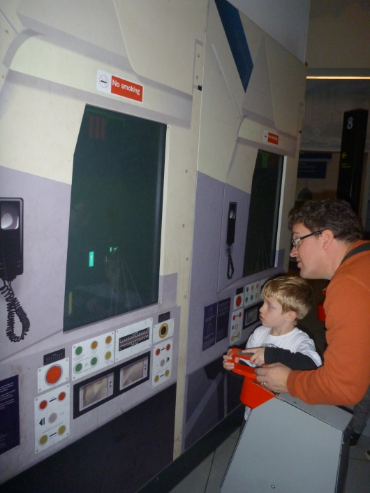 The boys working another of the driving simulation games at the London Transport Museum.