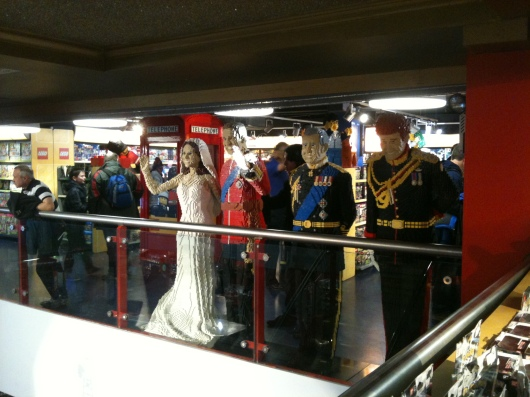 The Royal Family greets visitors at Hamleys in London.
