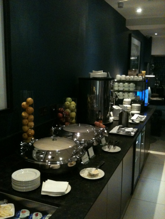 Long shot of the breakfast buffet at the executive lounge of The Waldorf Hilton, London.