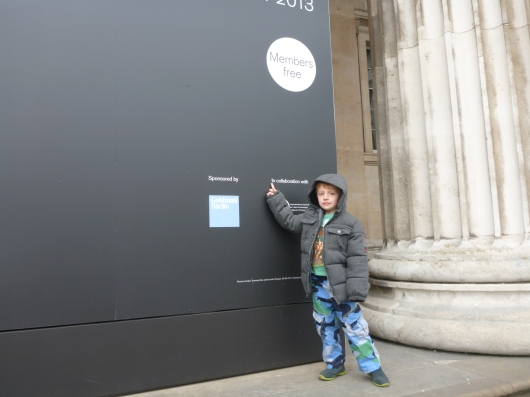 "T finds his ""popper word"" on a sign in front of the British Museum."