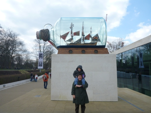 C and T in front of a ship-in-bottle out back of the National Maritime Museum in Greenwich Park.