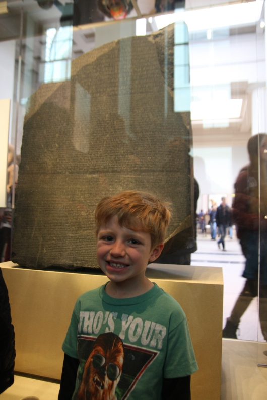 T in front of the Rosetta Stone at the British Museum.