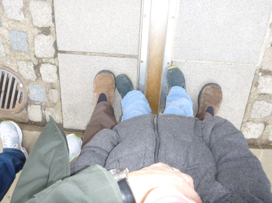 C and T's feet in queue and across the Prime Meridian. We waited about 15 minutes or so for our real photo opps. Not too bad!