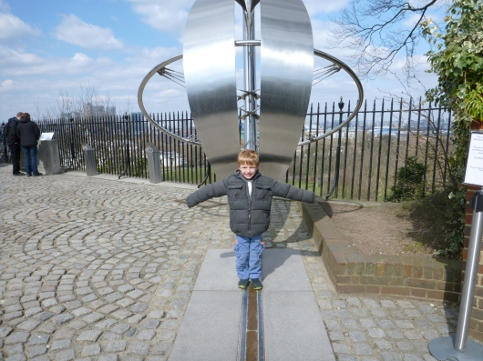 T straddling the Prime Meridian at Royal Observatory, Greenwich.