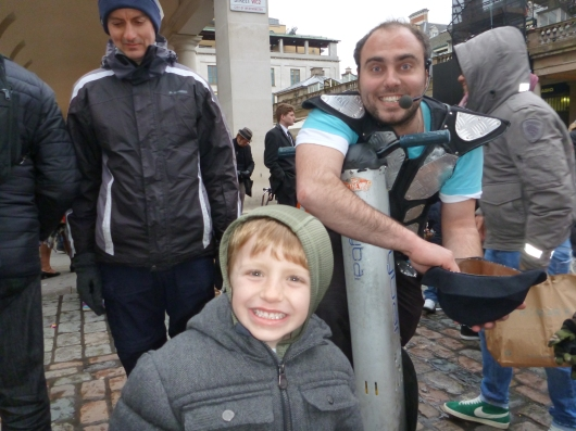 T with his favorite of the street performers we saw while in London's Covent Garden.