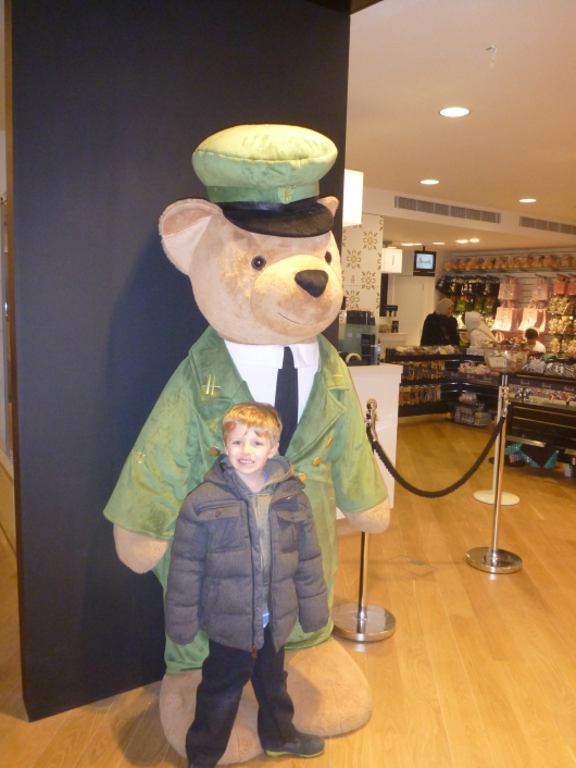 T with one of the Harrods Bears on guard in the gift department of the store.