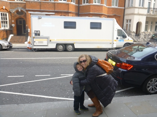 T and I in front of a mobile command police unit in front of the Embassy for Ecuador in London. You know, just in case you-know-who decides to step out for some fresh air!