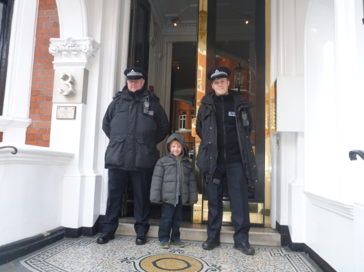 London police keep watch outside of the Embassy for Ecuador in London. Thanks for the photo, guys!