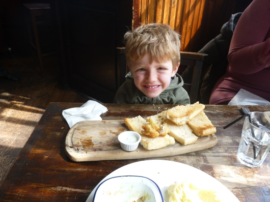 T and what's left of his fish stick sandwich. I guess he liked the fish at The Tea Clipper!