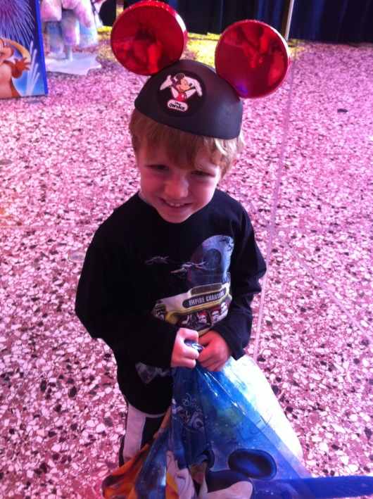T with his cotton candy and ears, all part of our Disney on Ice traditions here at home in Long Beach (CA).