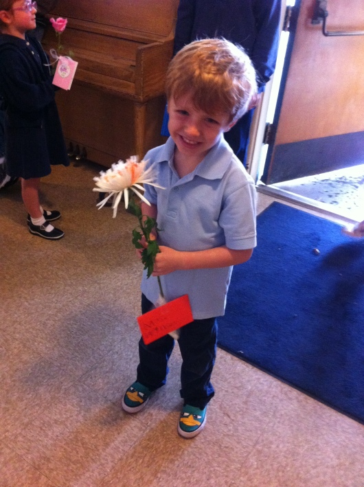 T is ready to greet his teacher Mrs. W on note-and-flower day of Teacher Appreciation Week.