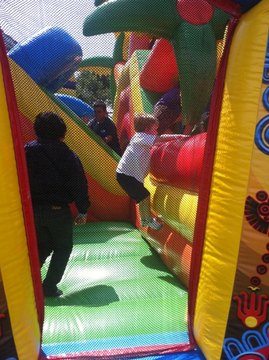 T climbing one of the maze walls of a jump at his school carnival. This one was crazy crowded!