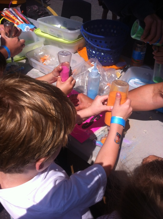 T making a sand craft at his school carnival.