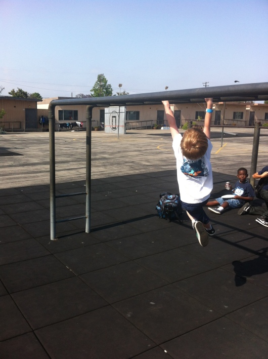 T's first time across the monkey bars was on the school playground during carnival. Yay!