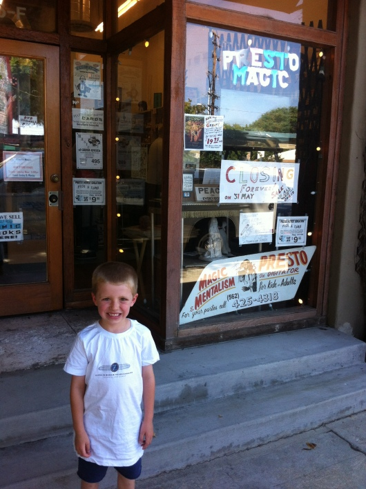 T in front of Presto Magic on Viking Way in Long Beach (CA). The store closes for good (no trick) tomorrow, May 31, 2013.