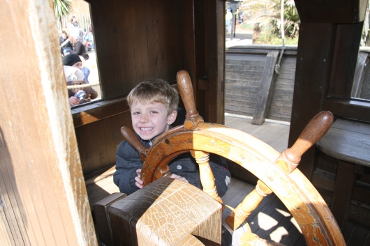 T steers the big pirate ship at the Diana, Princess of Wales' Memorial Playground in London's Kensington Gardens.
